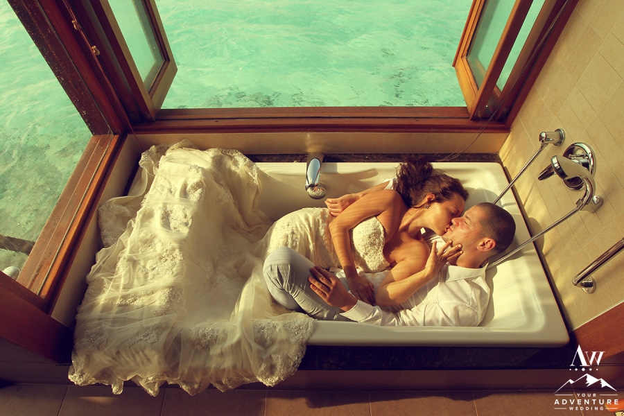 Bride and groom in bath tub in Maldives